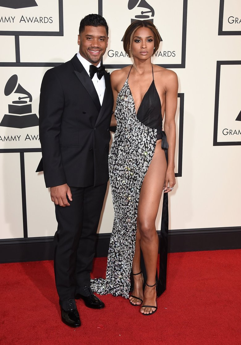 In this Feb. 15, 2016 file photo, Seattle Seahawks quarterback Russell Wilson, left, and singer Ciara arrive at the 58th annual Grammy Awards  in Los Angeles. A representative for Ciara confirms that the couple are engaged. Russell posted a video on his Facebook page Friday, March 11, 2016, showing himself next to Ciara, who was wearing a bright ring. (Photo by Jordan Strauss/Invision/AP)