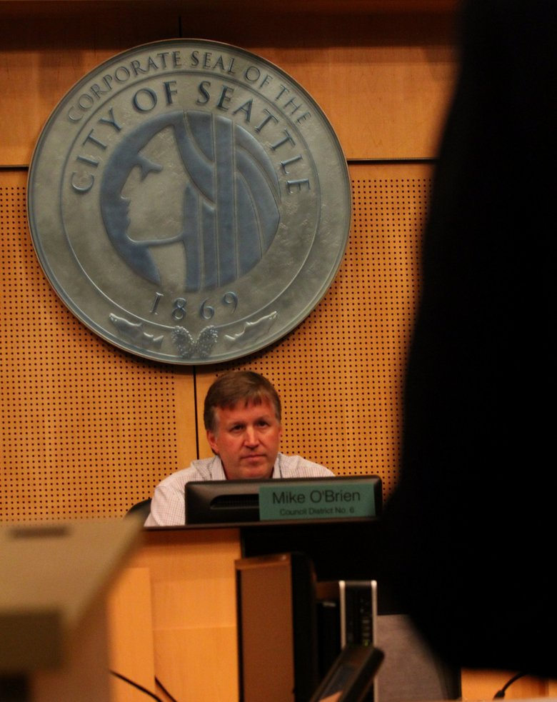 Hearing chair Mike O'Brien listens to a speaker, each given two minutes.  (Alan Berner / The Seattle Times)