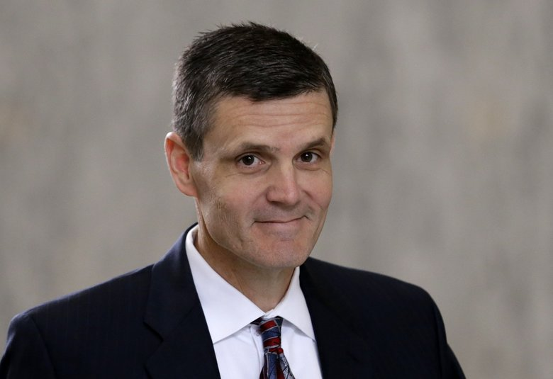 State Auditor Troy Kelley  as he leaves the federal courthouse in Tacoma last June. (Elaine Thompson / The Associated Press)