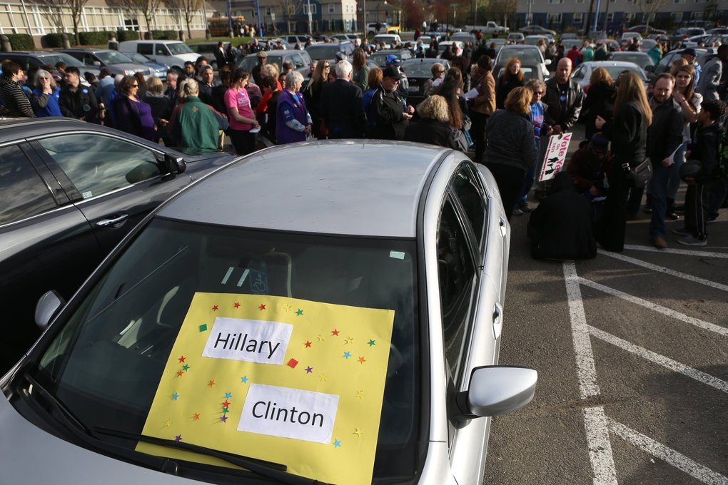 People line up outside Rainier Beach High School in Seattle to see Hillary Clinton give a public appearance on Tuesday for her presidential campaign. (Bettina Hansen / The Seattle Times)