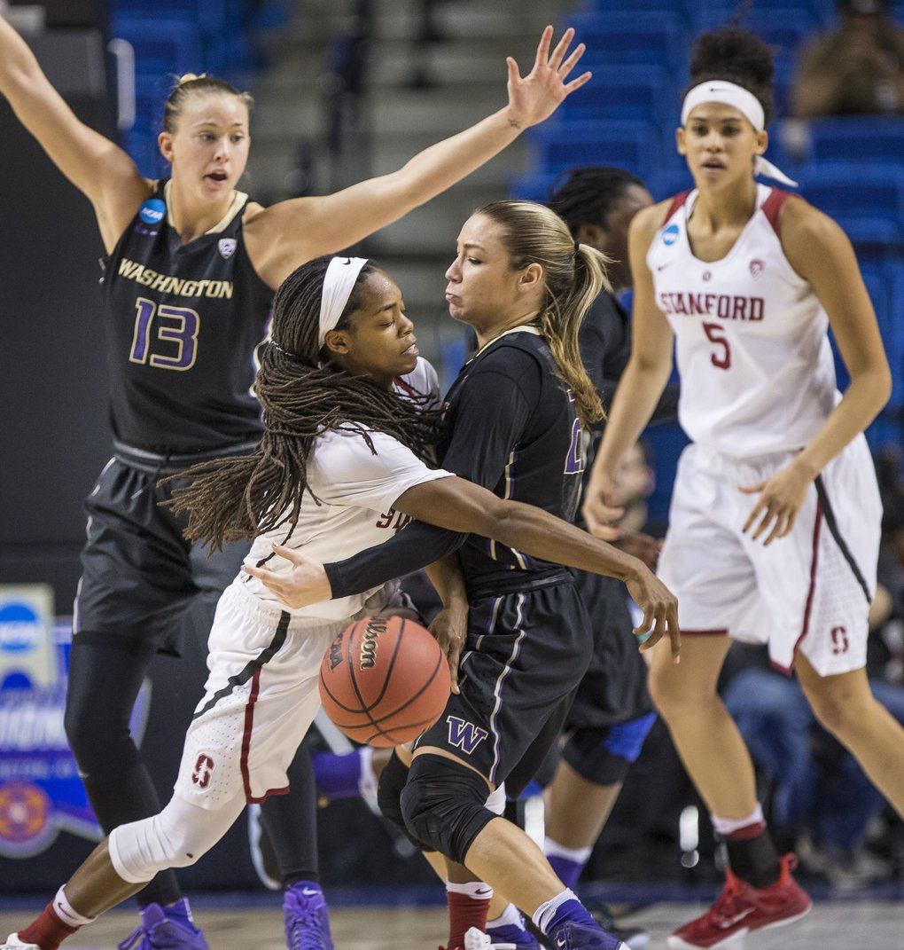 Washington's Alexus Atchley forces Stanford's Lili Thompson into a turnover in the final minute of play, taking a swipe at the pass at the top of the key. (Dean Rutz / The Seattle Times)