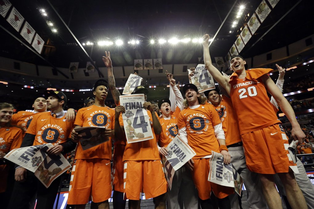 Syracuse players celebrate after an NCAA college basketball game against Virginia in the regional finals of the NCAA Tournament, Sunday, March 27, 2016, in Chicago. Syracuse won 68-62. (AP Photo/Nam Y. Huh)
