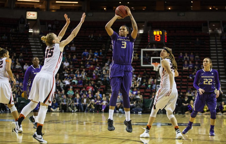 Talia Walton takes the open three in the first half against Oregon State.  (Dean Rutz/The Seattle Times)
