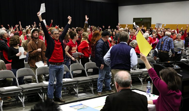 Hundreds turn out at the Greater Tacoma Convention and Trade Center for a meeting last month on a proposed methanol plant. The attendees are standing in support of a speaker who opposes the plan to build the methanol plant in Tacoma.  (Ken Lambert/The Seattle Times)