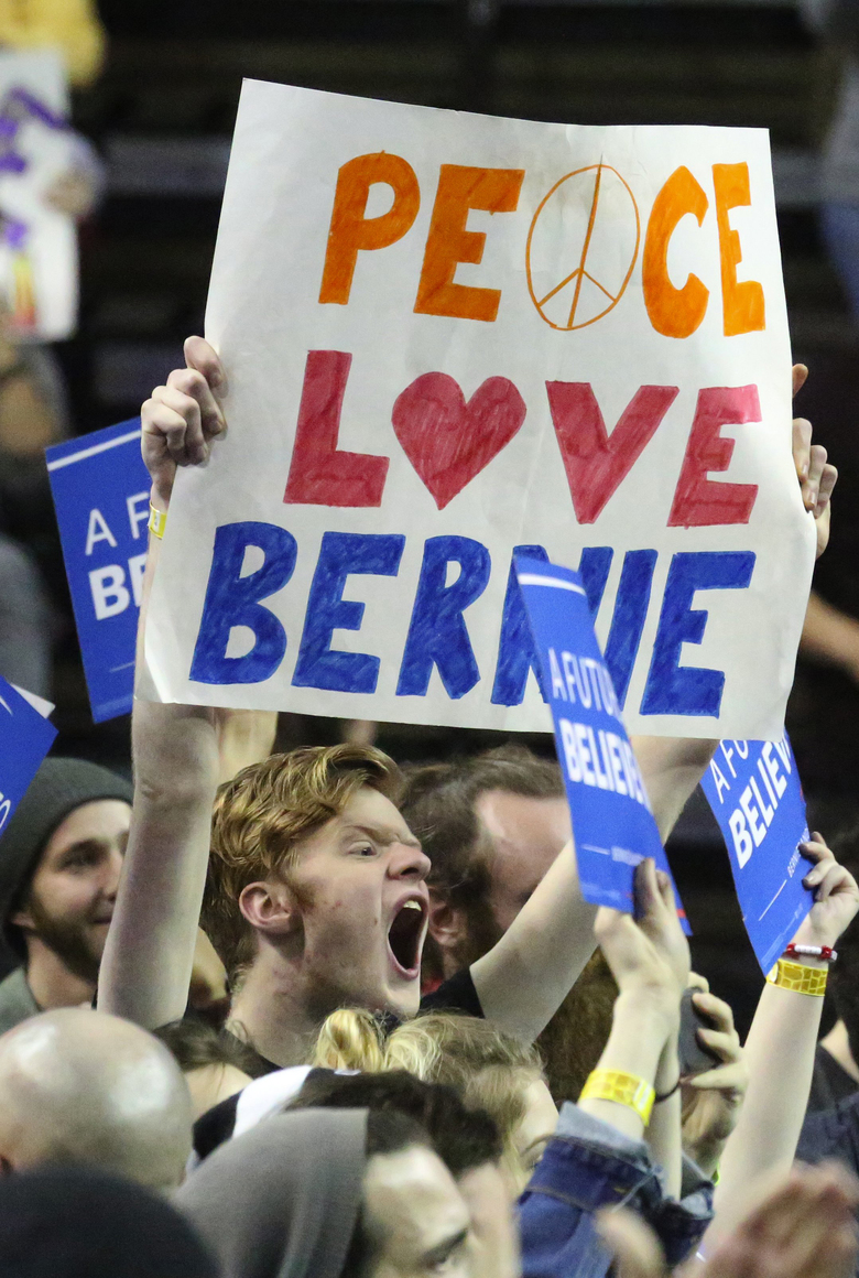 A supporter cheers with the huge crowd that turned out to hear Bernie Sanders' call for political reform.  (Ken Lambert/The Seattle Times)