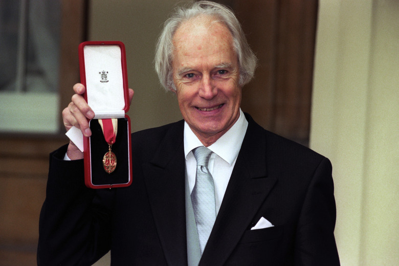 FILE – In this Nov. 12, 1996 file photo, Sir George Martin poses for the media with his knighthood at Buckingham Palace, London. George Martin, the Beatles' urbane producer who quietly guided the band's swift, historic transformation from rowdy club act to musical and cultural revolutionaries, has died, his management said Wednesday March 9, 2016. He was 90. (Neil Munns/PA via AP)