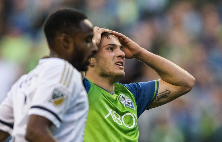 Jordan Morris reacts to a shot that is blocked in the first half. (Dean Rutz / The Seattle Times)