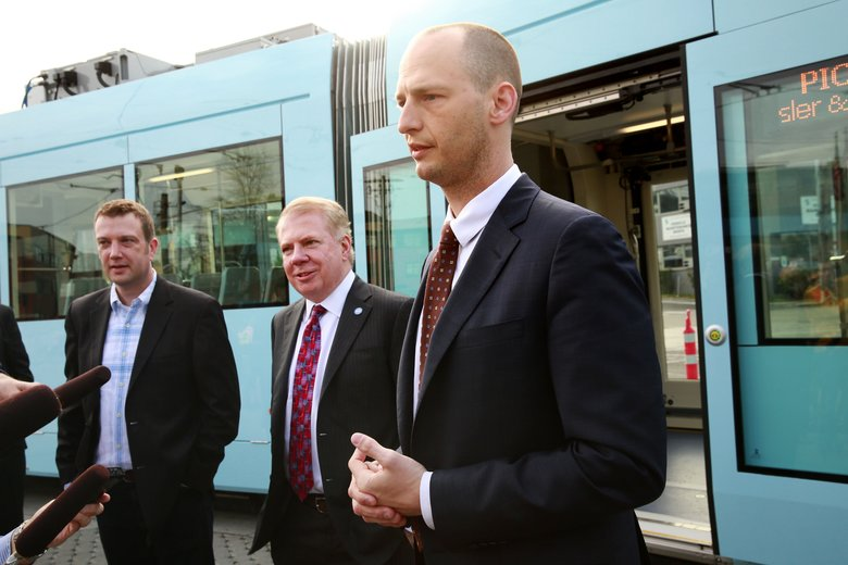Mayor Ed Murray (center) and Seattle Department of Transportation Director Scott Kubly (right) talk during a media tour of the new streetcar maintenance facility in 2015.  (Erika Schultz/The Seattle Times)
