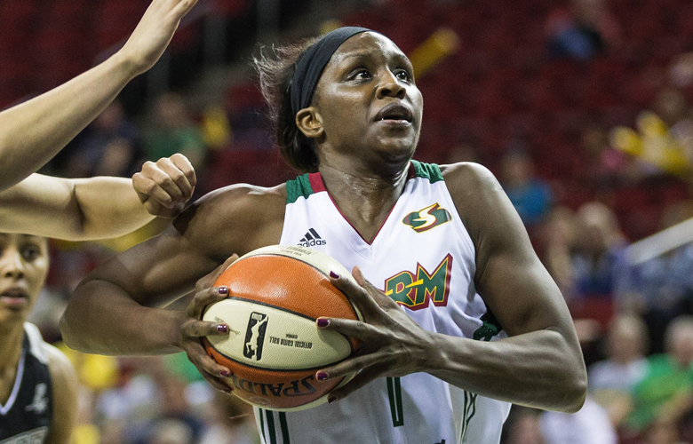 Seattle's Crystal Langhorne gets position in the lane and scores on San Antonio's Dearica Hamby to give the Storm a 16-14 lead on the Stars in the first half Friday.