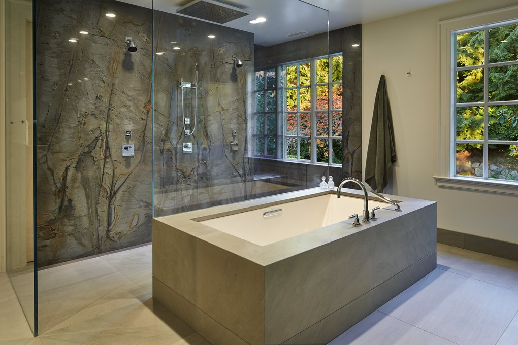 """Silk says his biggest design issue arose in the master bathroom: Because he couldn't move the window, he had to build a niche in the soapstone shower wall. (""""He just didn't want people to see my cheap shampoo,"""" Kirley jokes.)  (Benjamin Benschneider/The Seattle Times)"""