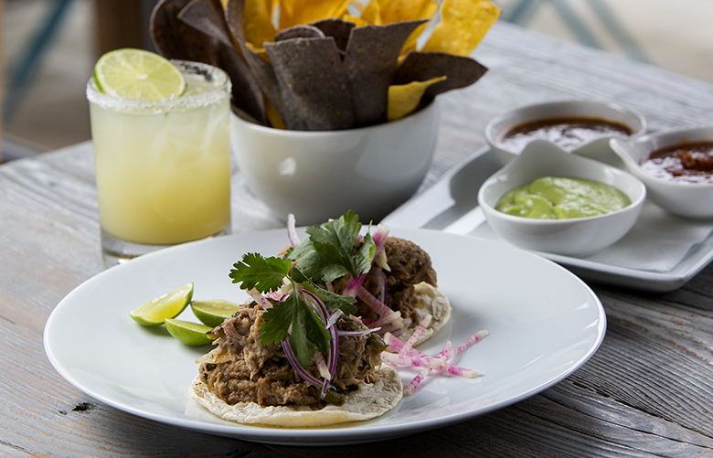 The braised barbecue pork and poblano tacos, with the trio of Salsas, and the Chazez margarita, at Chavez, located at 1734 12th Avenue, in the Capitol Hill neighbor of Seattle, Saturday, May 22, 2016.