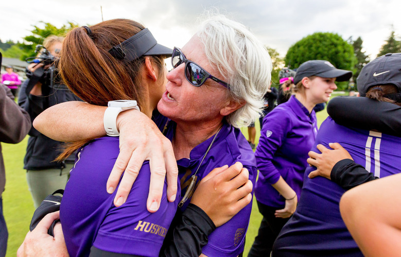 Mary Lou Mulflur celebrates with her team after the University of Washington women's golf team defeated Stanford to win its first  NCAA  championship at the Eugene Country Club on Wednesday. (Scott Eklund / Red Box Pictures)