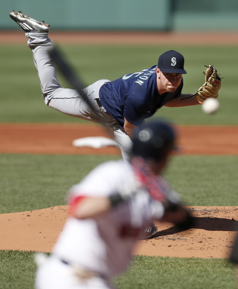 image of Adrian Sampson delivering a pitch