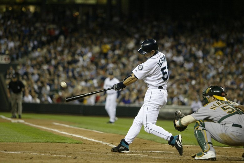 Ichiro strokes an RBI single during a 2003 game at Safeco Field. (Rod Mar/The Seattle Times)
