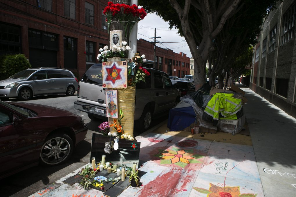 A memorial for Luis Gongora, a homeless man killed by police in April, stands May 14 near 18th and Shotwell streets in the Mission District of San Francisco. Police said that Gongora had lunged at them with a knife, but witnesses interviewed by local media outlets said the attack was unprovoked, and police commands in English were likely misunderstood by Gongora, a Spanish speaker.  (Bettina Hansen/The Seattle Times)