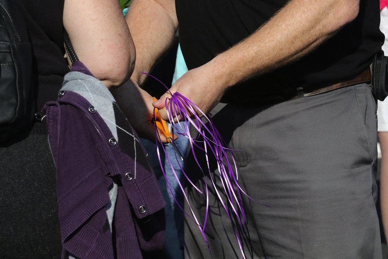 Ribbons, in Kamiak High School purple, are prepared for the vigil.  (Alan Berner / The Seattle Times)