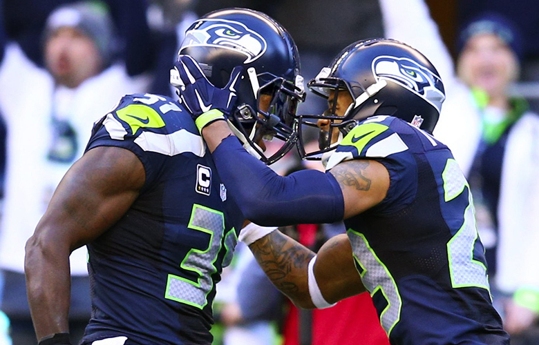 Seahawks safety Kam Chancellor and Seahawks safety Earl Thomas celebrate during the second half as the Seattle Seahawks play the Arizona Cardinals at CenturyLink Field in Seattle on Sunday November 23, 2014.