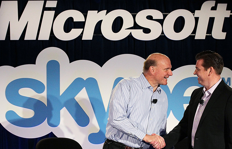 SAN FRANCISCO, CA – MAY 10:  Microsoft CEO Steve Ballmer (L) shakes hands with Skype CEO Tony Bates during a news conference on May 10, 2011 in San Francisco, California.