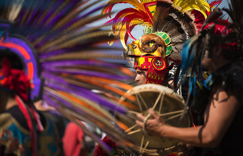 Angel Lopez of Kalpulli Tlaloktecuhitli Aztec Dance performs during the Duwamish River Festival at the Duwamish Waterway Park in Seattle on Saturday, Aug.