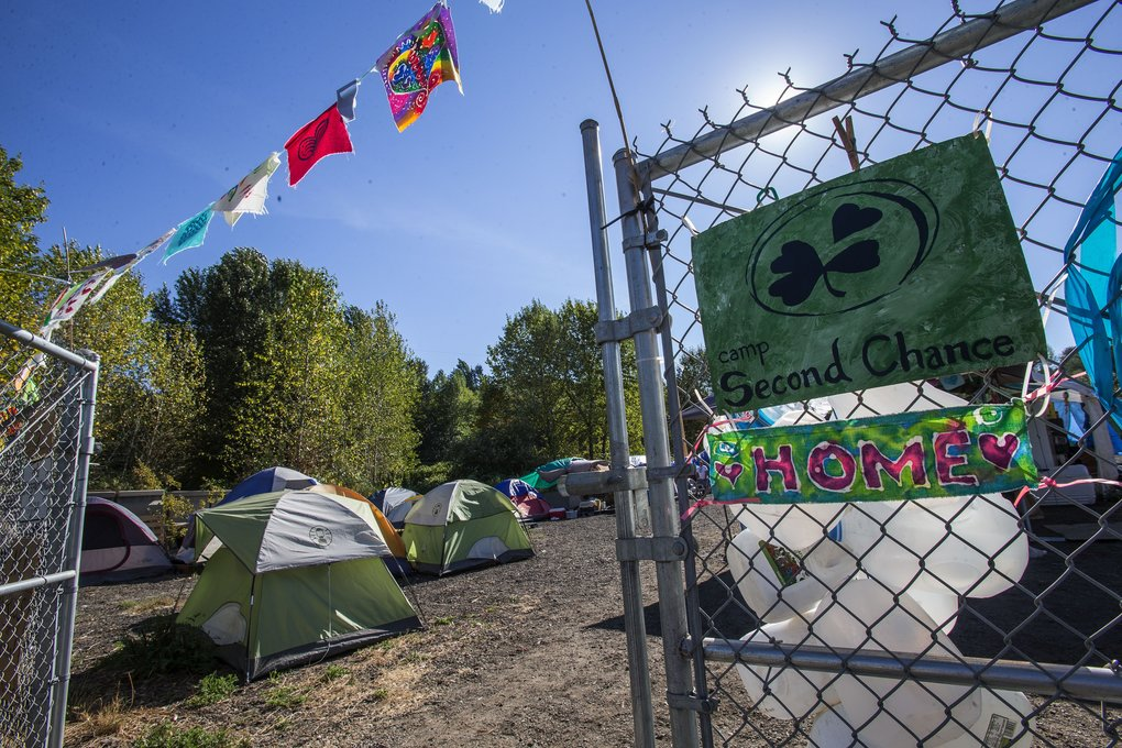 The ACLU and other advocacy groups will ask the Seattle City Council to protect homeless encampments on public property — like Camp Second Chance on surplus city property south of downtown — from forced eviction. (Dean Rutz/The Seattle Times)