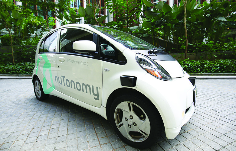 An autonomous vehicle is parked for its test drive in Singapore Wednesday, Aug. 24, 2016. The world's first self-driving taxis, operated by nuTonomy, an autonomous vehicle software startup, will be picking up passengers in Singapore starting Thursday, Aug. (AP Photo/Yong Teck Lim)