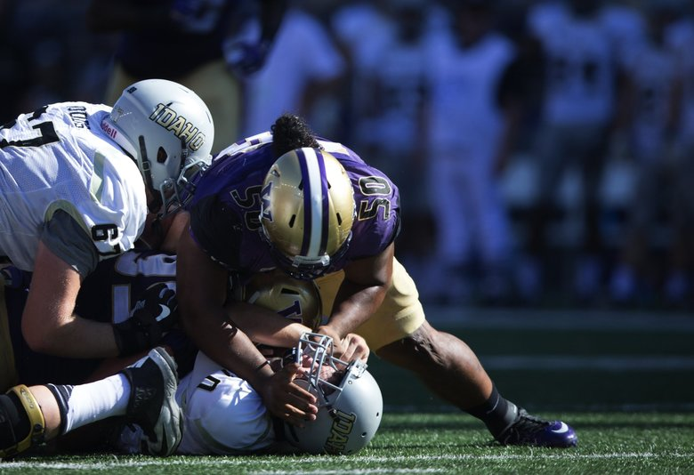 Washington Huskies defensive lineman Vita Vea smashes Idaho Vandals quarterback Matt Linehan to the ground for a loss of 6 yards in the second quarter against the Idaho Vandals at Husky Stadium on Saturday, Sept. 10, 2016.   (Lindsey Wasson / The Seattle Times)