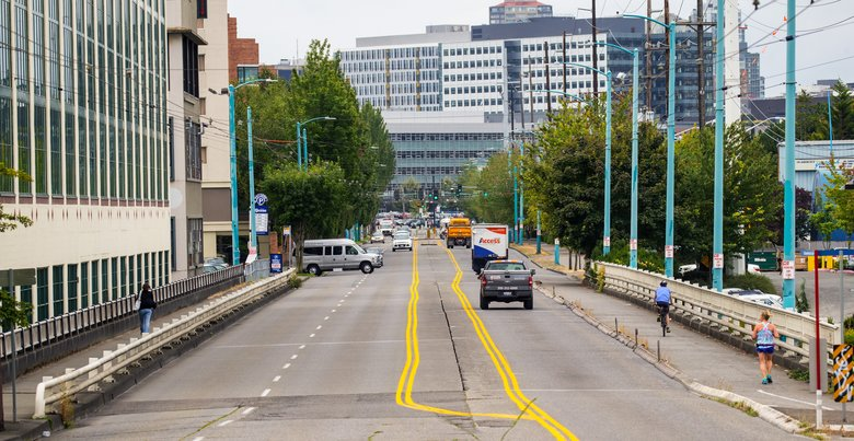 The Fairview Avenue North Bridge, seen with ZymoGenetics on the left. New construction in the South Lake Union neighborhood looms in the distance.  (Mike Siegel/The Seattle Times)