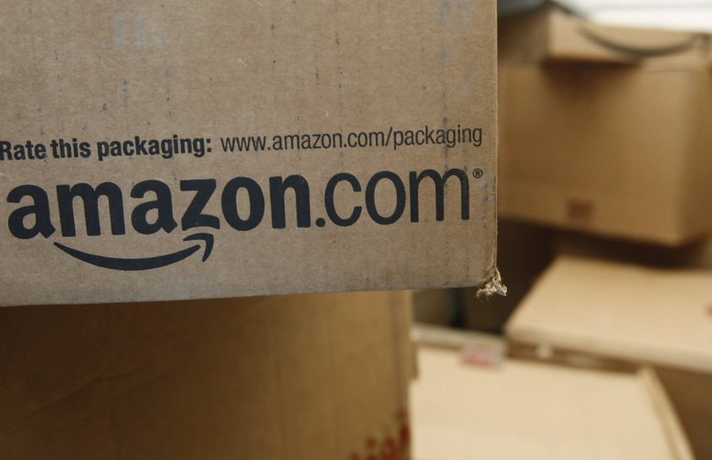 Amazon reported a nearly 30 percent increase in sales for the third quarter. (Paul Sakuma/AP)