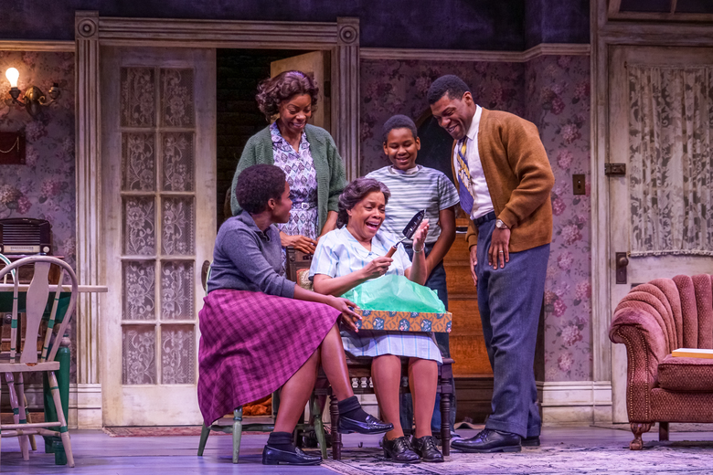 "Claudine Mboligikpelani Nako (Beneatha Younger), Mia Ellis (Ruth Younger), Denise Burse (Lena Younger), Catalino Manalang (Travis Younger) and Richard Prioleau (Walter Lee Younger) in ""A Raisin in the Sun"" at Seattle Repertory Theatre. (Alan V. Alabastro)"
