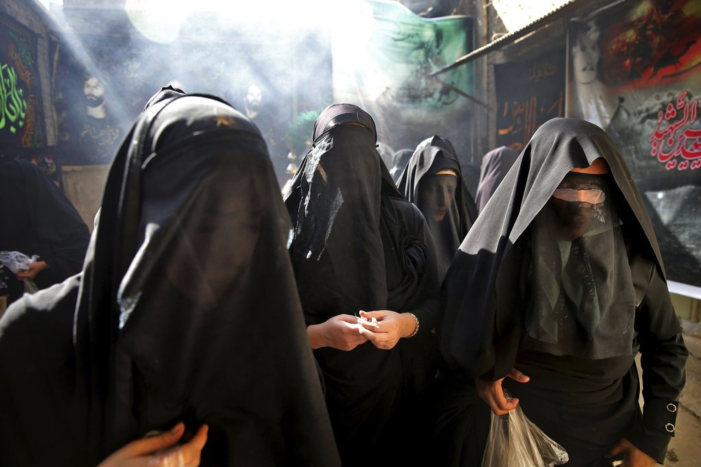 This picture taken on Tuesday, Oct. 11, 2016, shows veiled Iranian women taking part in a mourning ceremony for Ashoura, as they cover their faces symbolically, in the city of Khorramabad, southwest of the capital Tehran, Iran. Shiites mark Ashoura, the tenth day of the Muslim month of Muharram, to commemorate the martyrdom of Imam Hussein, a grandson of Prophet Muhammad and one of Shiite Islam's most beloved saints, during the 7th century Battle of Karbala in present-day Iraq. (AP Photo/Ebrahim Noroozi)