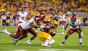 Washington State Cougars defensive lineman Derek Moore, linebacker Frankie Luvu, and safety Robert Taylor, right, tackle Arizona State QB Dillon Sterling-Cole after their starter went out injured as the Washington State Cougars take on the Arizona State Sun Devils at Sun Devil Stadium in Tempe, Arizona Saturday October 22, 2016. (Bettina Hansen / The Seattle Times)