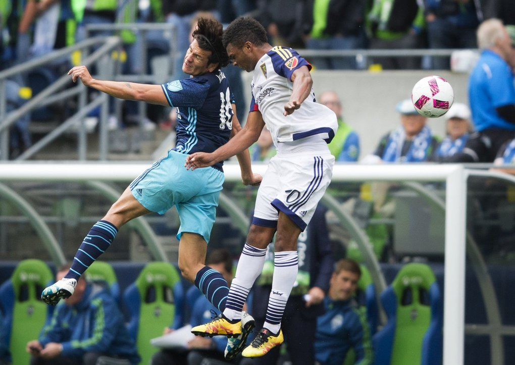 Seattle Sounders midfielder Nicolas Lodeiro redirects the ball backwards against Real Salt Lake midfielder Jordan Allen in the second half. (Lindsey Wasson / The Seattle Times)
