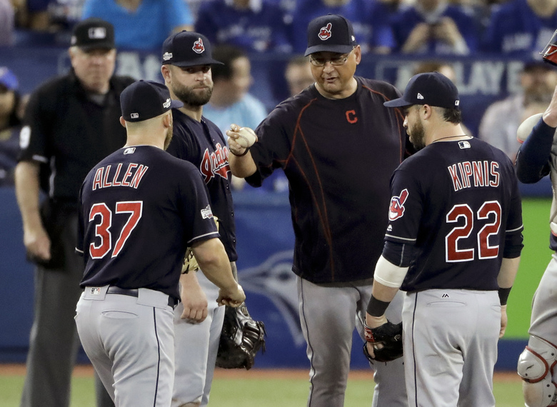 Cleveland Indians manager Terry Francona, middle, puts relief pitcher Cody Allen (37) in the game as second baseman Jason Kipnis (22) looks on during the seventh inning in Game 3 of baseball's American League Championship Series against the Toronto Blue Jays in Toronto, Monday, Oct. 17, 2016. (AP Photo/Charlie Riedel)