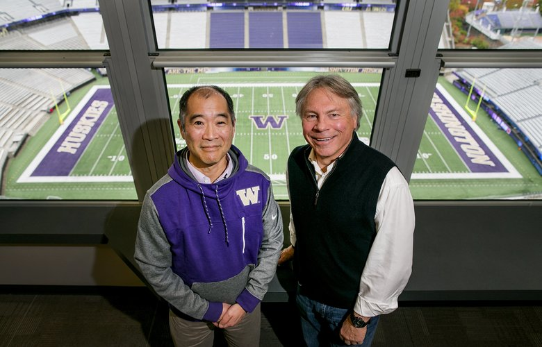 University of Washington play-by-play announcer Bob Rondeau, right, and stat crew chief Craig Heyamoto pose for a portrait in their work area on Thursday, October 20, 2016, at Husky Stadium in Seattle.