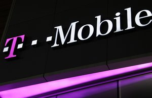 A sign for a T-Mobile store is displayed, Wednesday, Nov. 9, 2011, in New York. T-Mobile is a subsidiary of Deutsche Telekom.