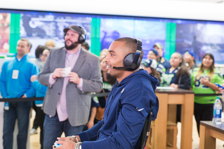 "Seahawks wide receiver Doug Baldwin plays ""Madden NFL 17"" for a charity event on Oct. 18, 2016, at the Microsoft Store at Bellevue Square. (Photo courtesy Microsoft)"