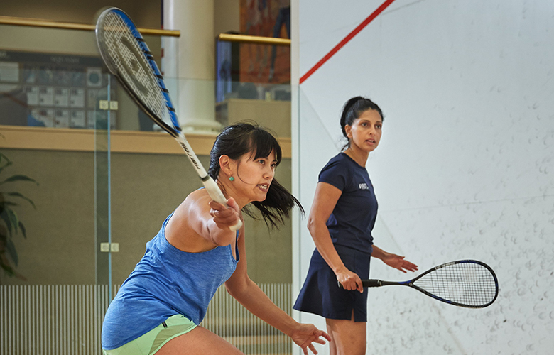 Pro Sports Club squash pro Shababa Khan, right works with Nicole Tsong.
