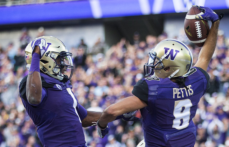 Washington wide receiver John Ross (1) and Washington wide receiver Dante Pettis (8) celebrate Pettis' 23 yard touchdown against Oregon State at Husky Stadium on Saturday, Oct.