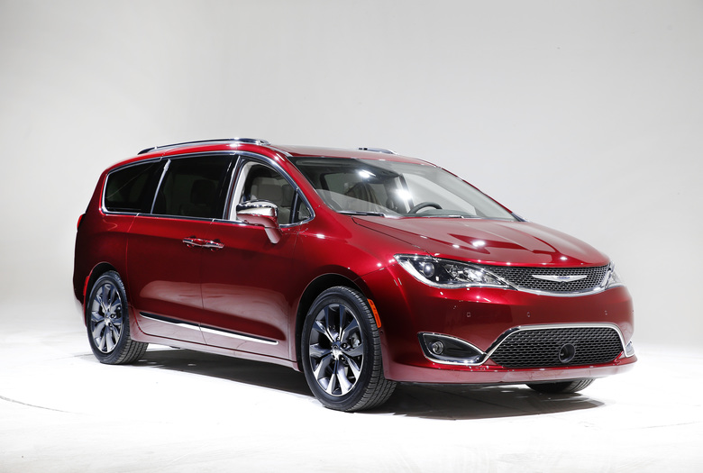 FILE – This Friday, Jan. 8, 2016, file photo, shows the 2017 Chrysler Pacifica, in Auburn Hills, Mich. Fiat Chrysler says its new gas-electric hybrid minivan will get the equivalent of 84 miles per gallon in electric mode and 32 mpg in city-highway mileage when in hybrid mode. The redesigned Chrysler Pacifica minivan went on sale earlier in 2016, and the hybrid version is due in showrooms in December. (AP Photo/Paul Sancya, File)