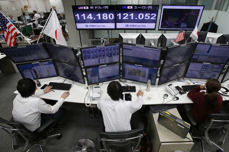 A monitor shows the current exchange rate between Japanese yen and U.S. dollar, rear left, and between yen and euro, rear right, at a foreign exchange brokerage in Tokyo Thursday, Dec. 1, 2016. Asian stock markets moved mostly higher on Thursday as upbeat factory data from China boosted investor sentiment. The dollar rose to 114.48 yen from 114.44 yen. The euro was flat at $1.0595.(AP Photo/Shuji Kajiyama)