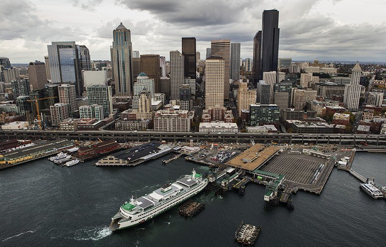 Colman Dock is seen below in this aerial view of Seattle on Nov. 11, 2015. ferry, seattle skyline  0435613298