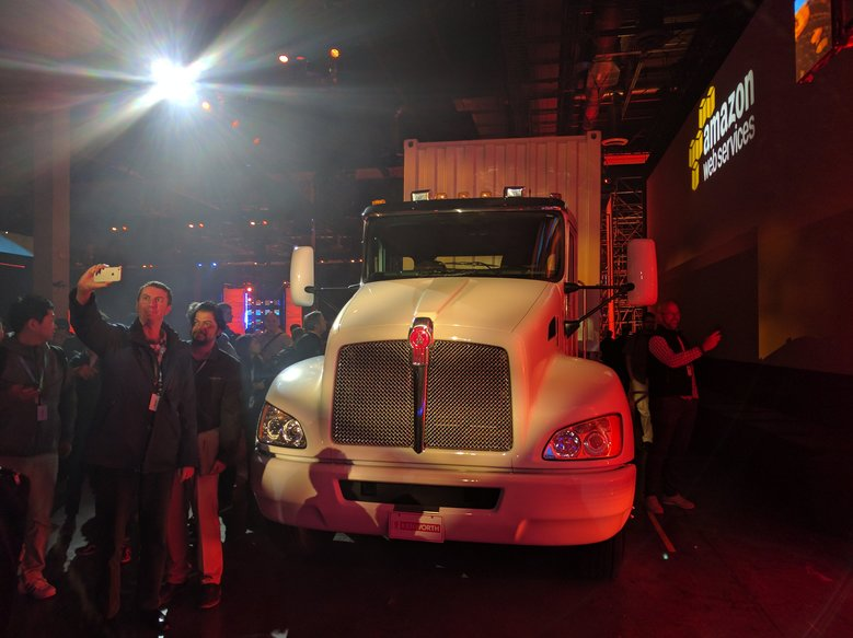 "A truck pulls ""Snowmobile,"" a device the size of a 45-foot trailer than can physically haul an exabyte of data from a customer's data center to Amazon's server farms. (Angel Gonzalez/The Seattle Times)"