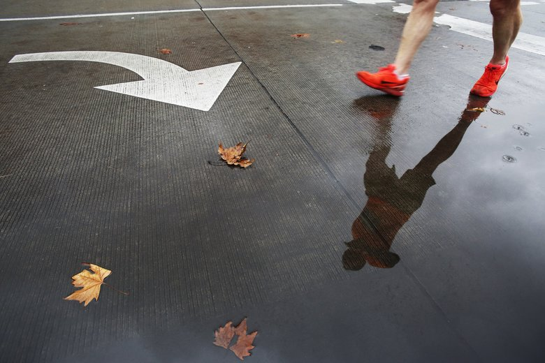 Runners had cool conditions Sunday..  (Logan Riely/The Seattle Times)