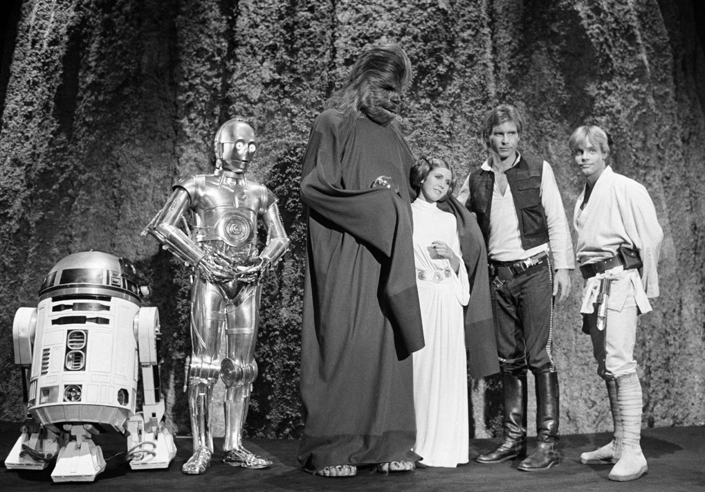 "Kenny Baker, Anthony Daniels, Peter Mayhew, Carrie Fisher, Harrison Ford and Mark Hamill, shown during the 1978 filming of ""The Star Wars Holiday"" TV special.  (AP Photo/George Brich, File)"