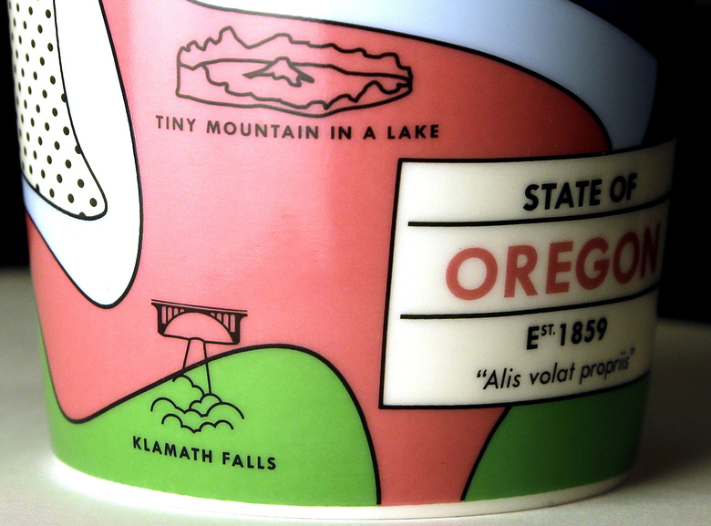 "Starbucks' Oregon-themed coffee mug shows a waterfall design identified as ""Klamath Falls."" No such waterfall exists. The drawing was likely meant to depict Multnomah Falls, a popular spot in the Columbia River Gorge.  (Don Ryan/AP)"