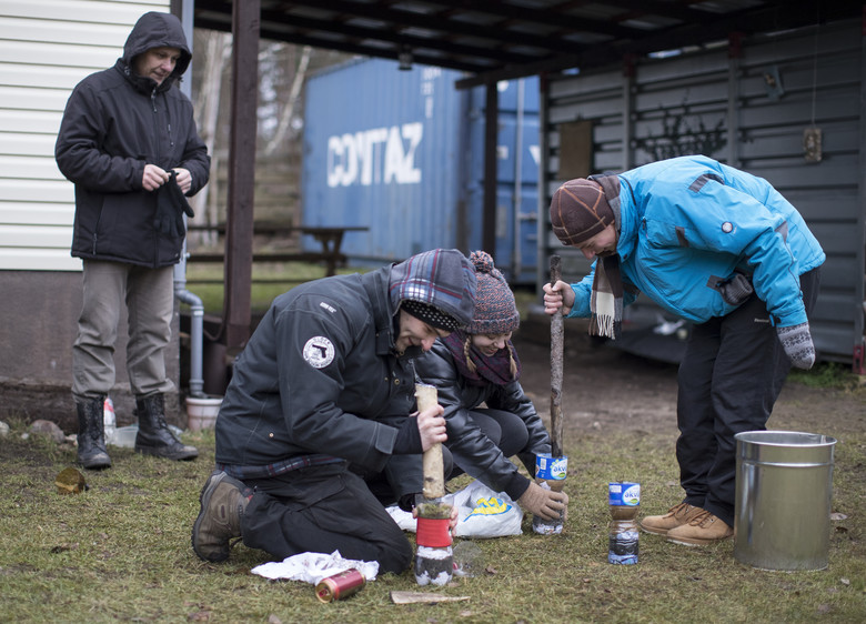 Lithuanian civilians learn how to filter dirty water during a survival course teaching them skills that some fear could be needed given Russia's resurgence, just outside of the capital Vilnius, Lithuania, Saturday, Nov. 26, 2016. Across the Baltic states of Lithuania, Latvia and Estonia, people fear Russia's large military buildup of forces and nuclear-capable missiles in Russia's Kaliningrad region and have raised questions about the loyalties of the ethnic Russians in the country, who make up about 6 percent of the population. (AP Photo/Mindaugas Kulbis)