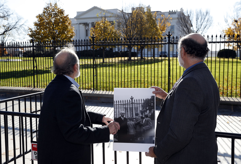 CORRECTS THAT THEY ARE SEEKING AN EXONERATION NOT A PARDON – Michael, left, and Robert Meeropol, the sons of Ethel Rosenberg, pose similar to an old photograph of them, before they attempt to deliver a letter to President Barack Obama in an effort to obtain a exoneration for their mother Ethel Rosenberg, in front of the White House, Thursday, Dec. 1, 2016 in Washington. Ethel Rosenberg was executed, along with her husband, Julius, in 1953 after being convicted in a Cold War atomic spying case that captivated the country. (AP Photo/Alex Brandon)
