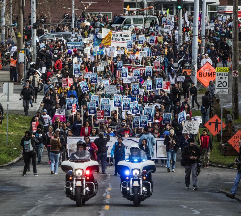 The 34th Annual MLK celebration march started at Garfield High School, went over Capitol Hill and down to the Seattle downtown Federal Building.   (Steve Ringman / The Seattle Times)