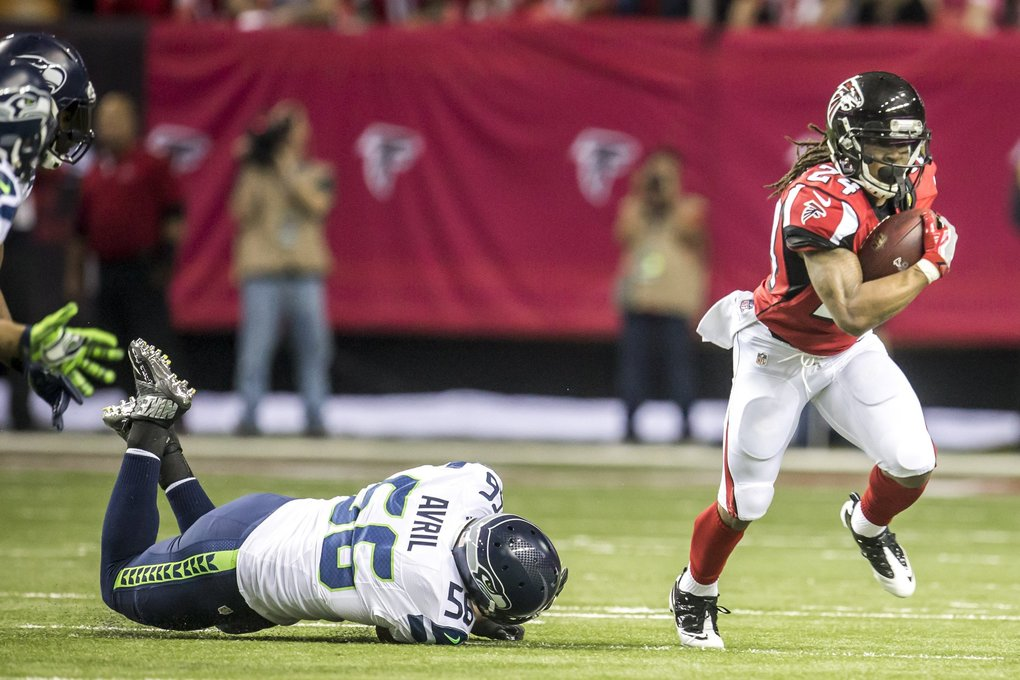 Falcons running back Devonta Freeman gets by Seahawks defensive end Cliff Avril for a first down on Atlanta's opening touchdown drive.   (Bettina Hansen / The Seattle Times)