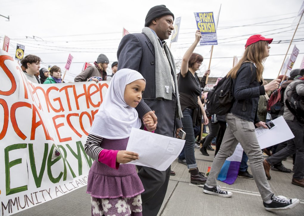 "Ahmed Robele marches with his daughter Nuriya, 8,  at the All United, None Divided Immigrant Rights March sponsored by El Comité, which merged with a march of students who walked out of class on the day of President Donald Trump's Inauguration Friday. ""I don't like what I see,"" said Robele, about President Trump's campaign remarks regarding Muslims, Mexicans and women. ""We are human beings. We are American,"" he said. Also, as an Oromo from Ethiopia who came to the United States 25 years ago, ""I don't want to see here what I see in Africa,"" he said.   (Bettina Hansen / The Seattle Times)"